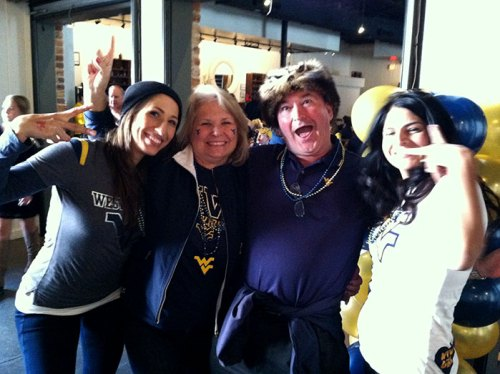 Tina and Paul flanked by fellow Mountaineer fans
