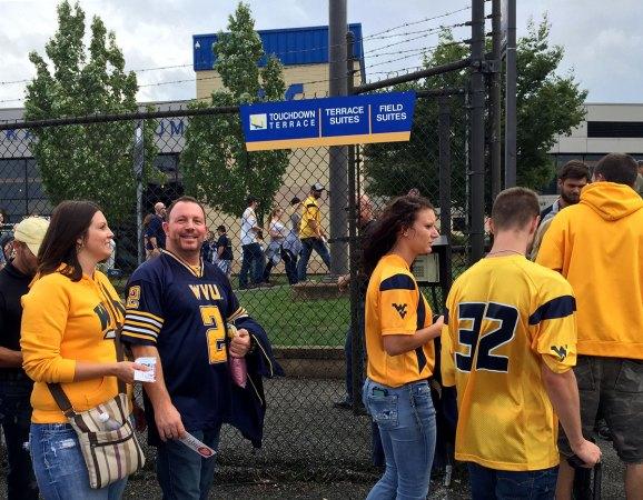 Doug and Melissa entering Touchdown Terrace gate