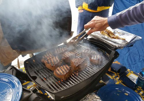 grilling-steaks at WVU vs. Texas tailgate