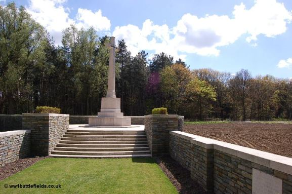 Cross of Sacrifice at Polygon Wood Cemetery, with the wood visible behind