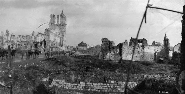 Canadian troops passing the ruins of the Cloth Hall. Image from Library and Archives Canada