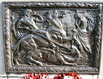 The central brass panel of the Tyneside Memorial seat