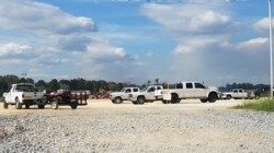 Many white trucks, Foreman Office Only 30.7605747, -83.5529692