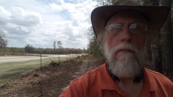 Red and white trucks coming in to Suwannee River HDD site from 24th Street,