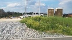 Construction equipment and porta-potties, 30.7605747, -83.5529692