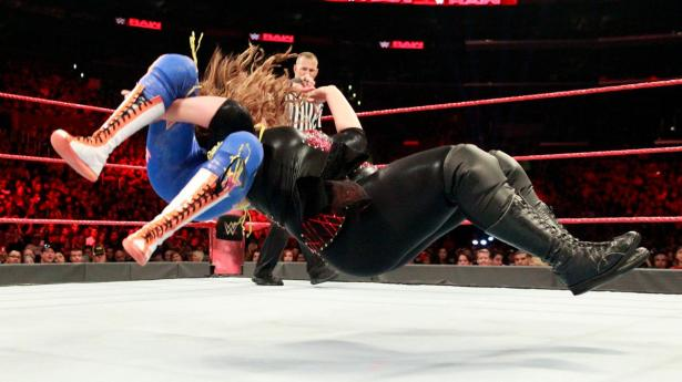 Jax plants Bayley with a Samoan Drop and gets the pin to eliminate The Huggable One.