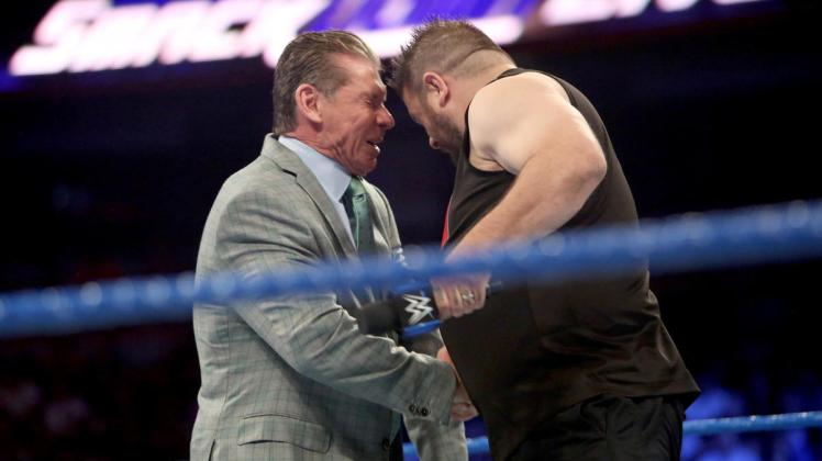 Image result for mcmahon wwe head budded by keven owens