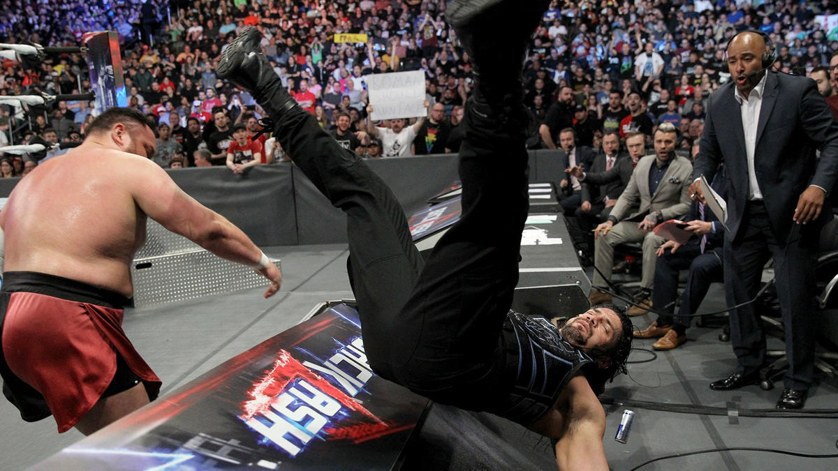 Joe sends Reigns plummeting through the table with a fierce Uranage!