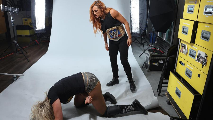 The Irish Lass Kicker ambushes The Queen during a photo session prior to SmackDown LIVE going on the air.