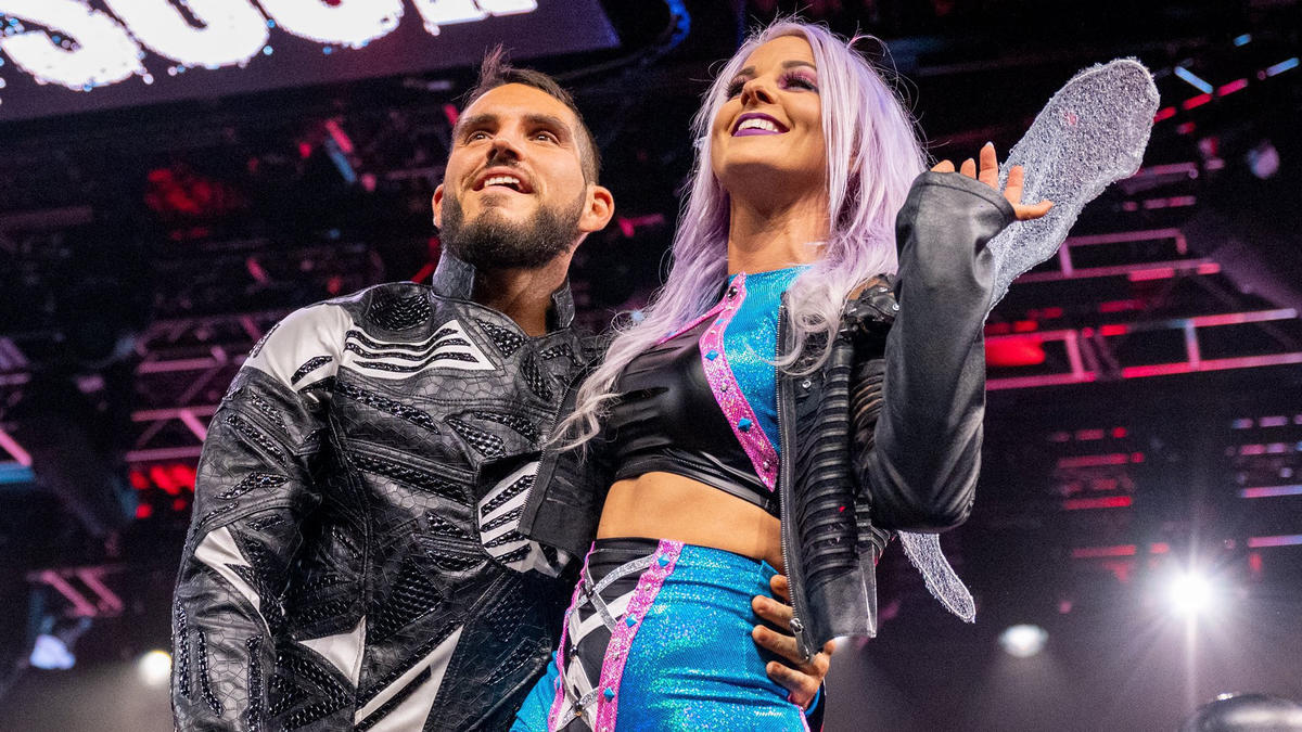 Johnny Gargano, Candice LeRae and their dog Pawdme' stage epic gender reveal