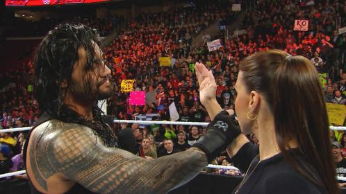 Roman Reigns catches the arm of Stephanie McMahon on Monday Night RAW