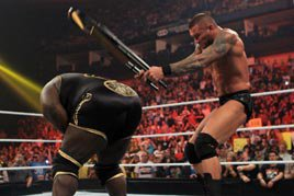 Orton attacks Henry with a chair at WWE Hell in a Cell