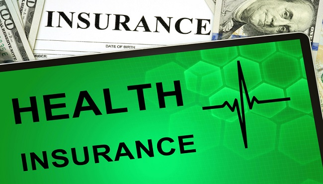 Tablet with Health insurance online and money._425138