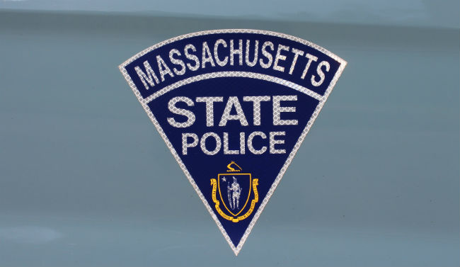 State trooper injured in crash caused by alleged distracted