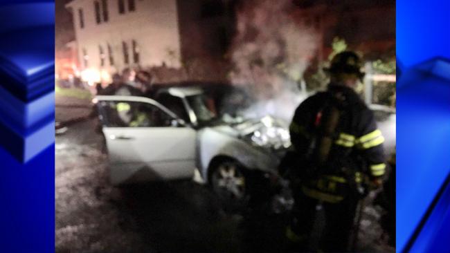 garage car fire blue_1557997466588.jpg.jpg