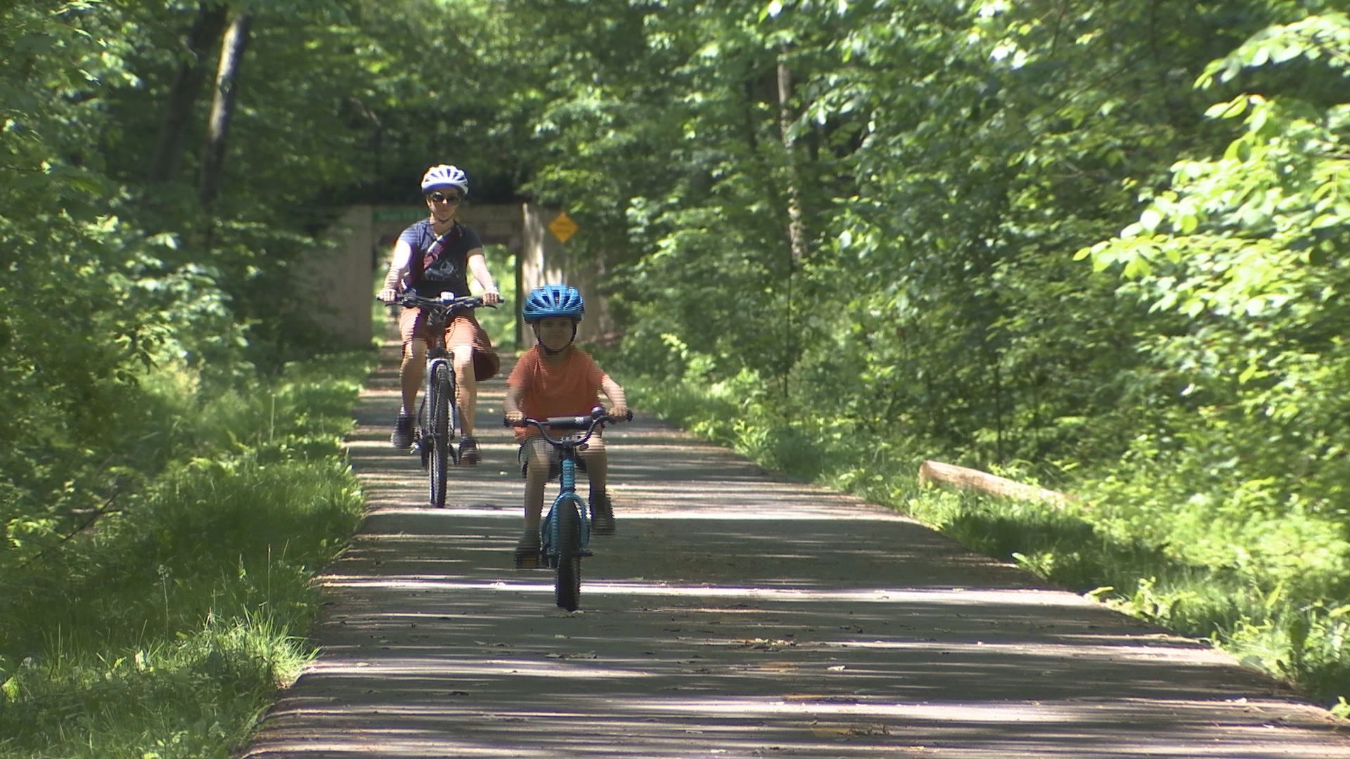 Local bicyclists take advantage of Friday's summer-like