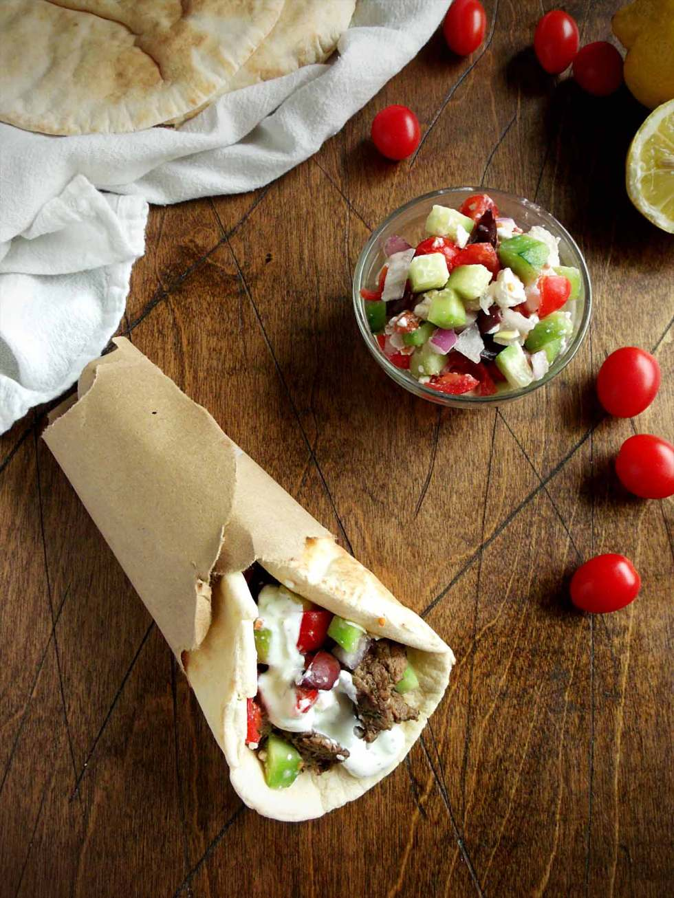 This recipe for greek gyros and tzatziki sauce is easy and healthy! Fresh tomato, cucumber, and feta are the perfect filling!