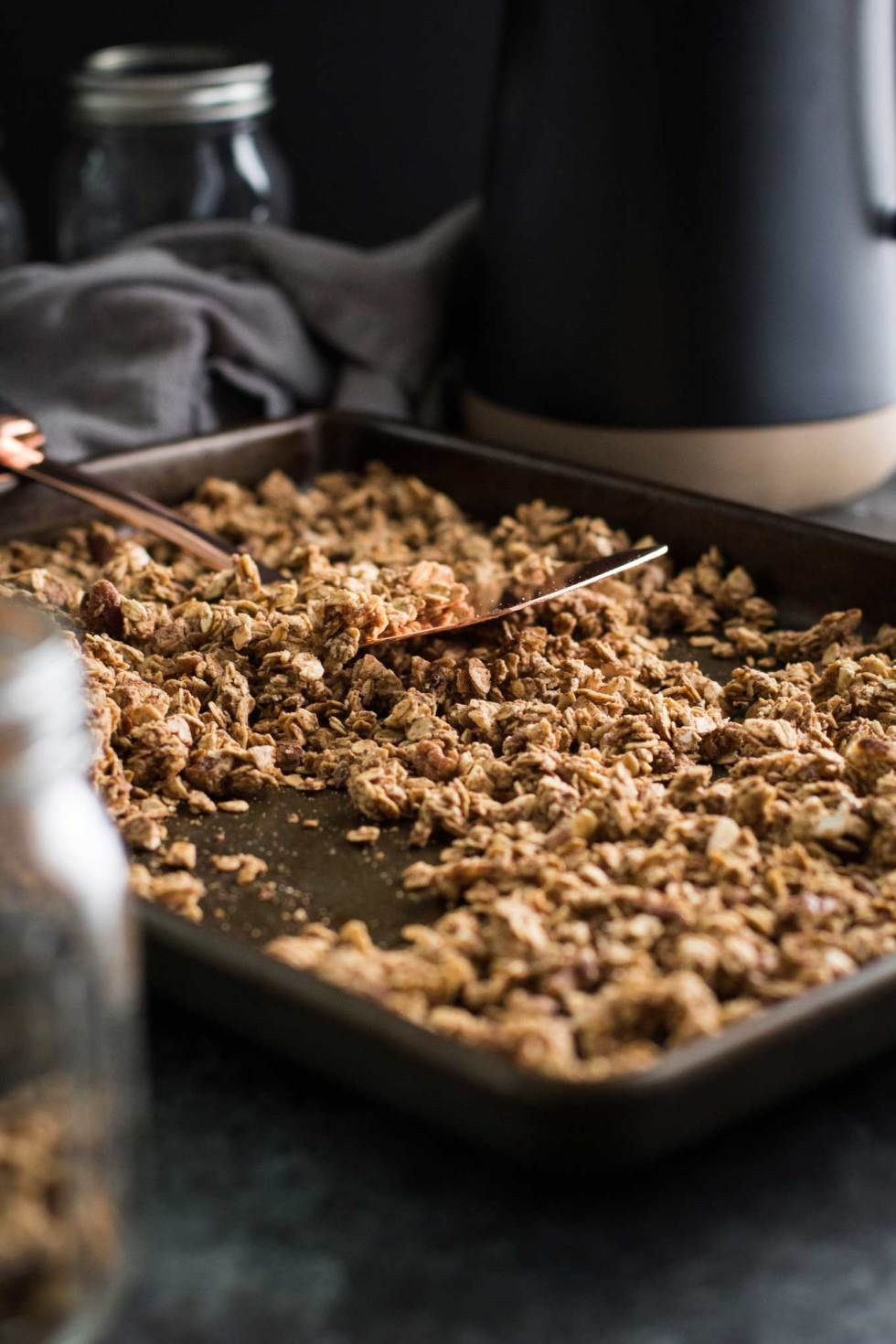 Chai spiced granola cooling on a cookie sheet