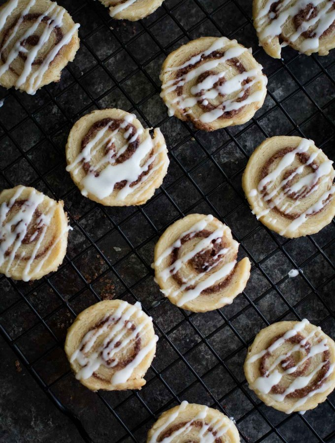 These melt-in-your-mouth cookies taste like a flakey cinnamon roll! Pastry rolled up with cinnamon sugar and drizzled with icing!