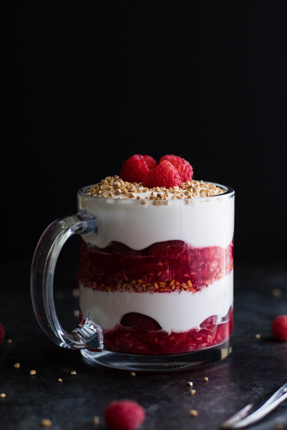 Cranachan! A delightful Scottish dessert made with whiskey, honey cream, raspberries, and toasted steel cut oats!