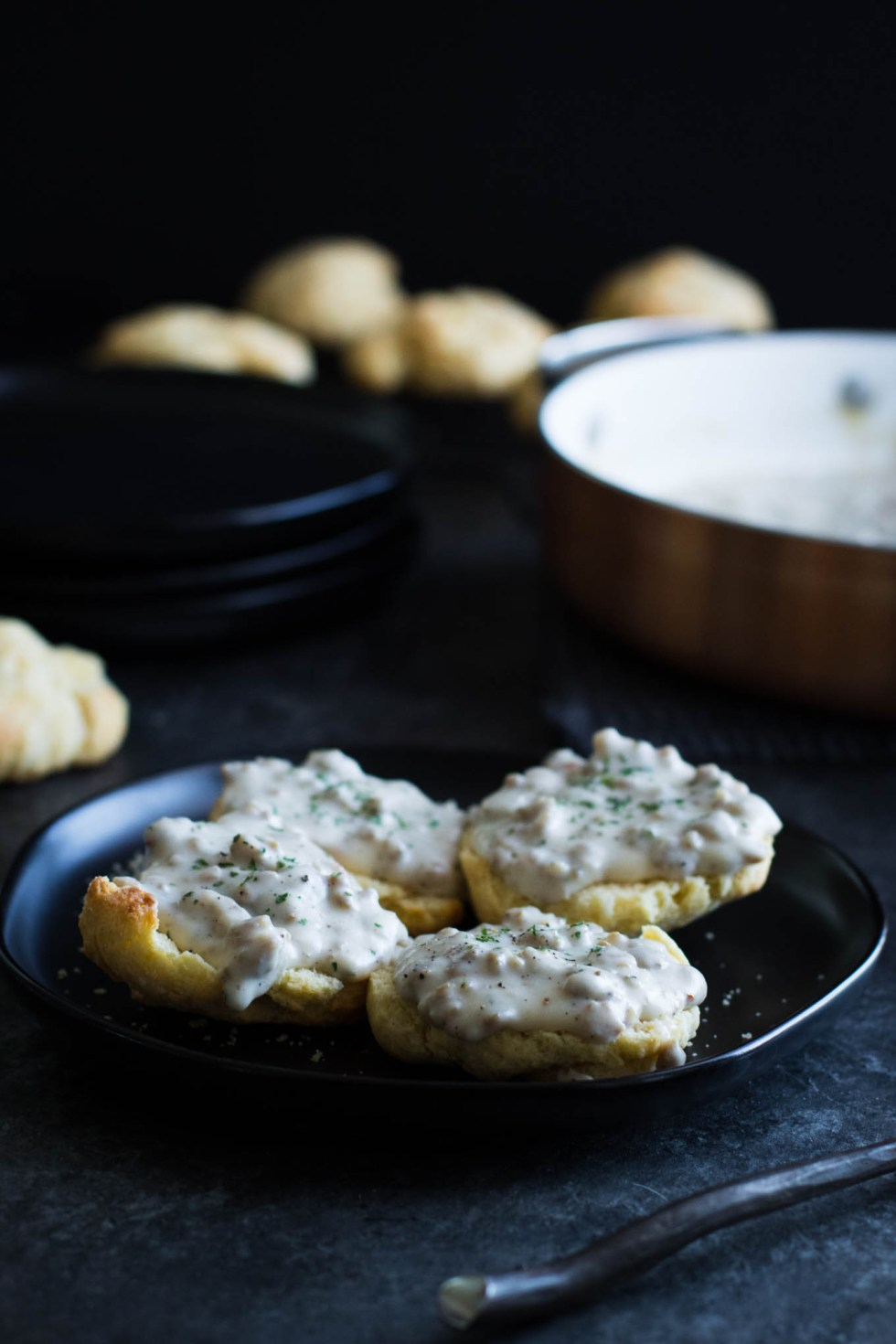 Quick and easy corn biscuits, smothered in homemade sausage gravy! This recipe is perfect for Saturday morning breakfast or Sunday brunch!