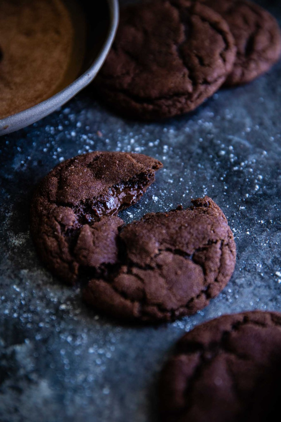 A snickerdiablo cookie broken in half with red chile ganache oozing out of the middle