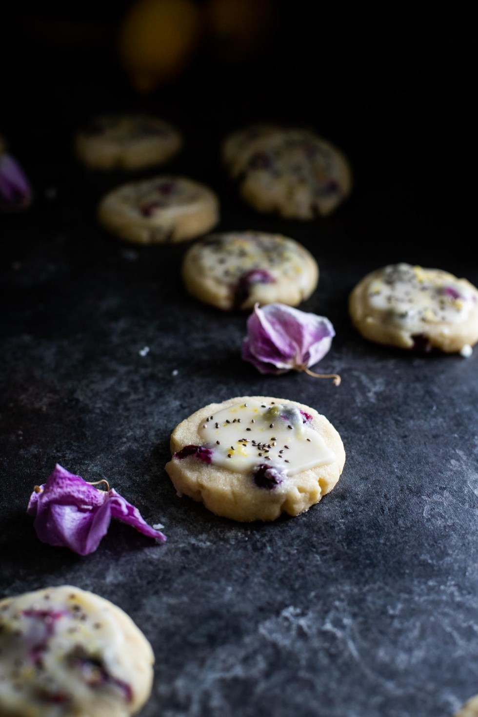 Delicious lemon sugar cookies with bright blueberries, lemon glaze, and chia seeds! These cookies are easy to make and perfect for sharing!