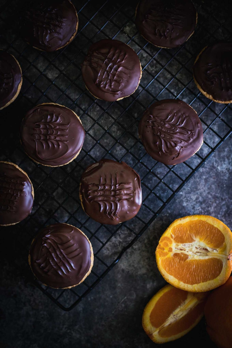 Sponge cake topped with orange jelly and semi-sweet chocolate! I fell in love with Jaffa Cakes while watching the Great British Baking Show and developed equivalent american measurements!