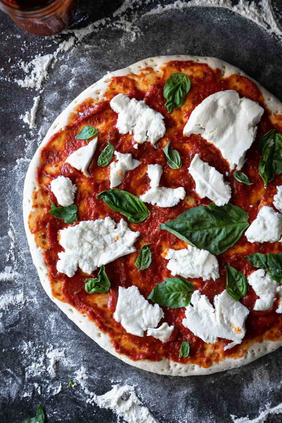 Close-up of margherita pizza before being baked