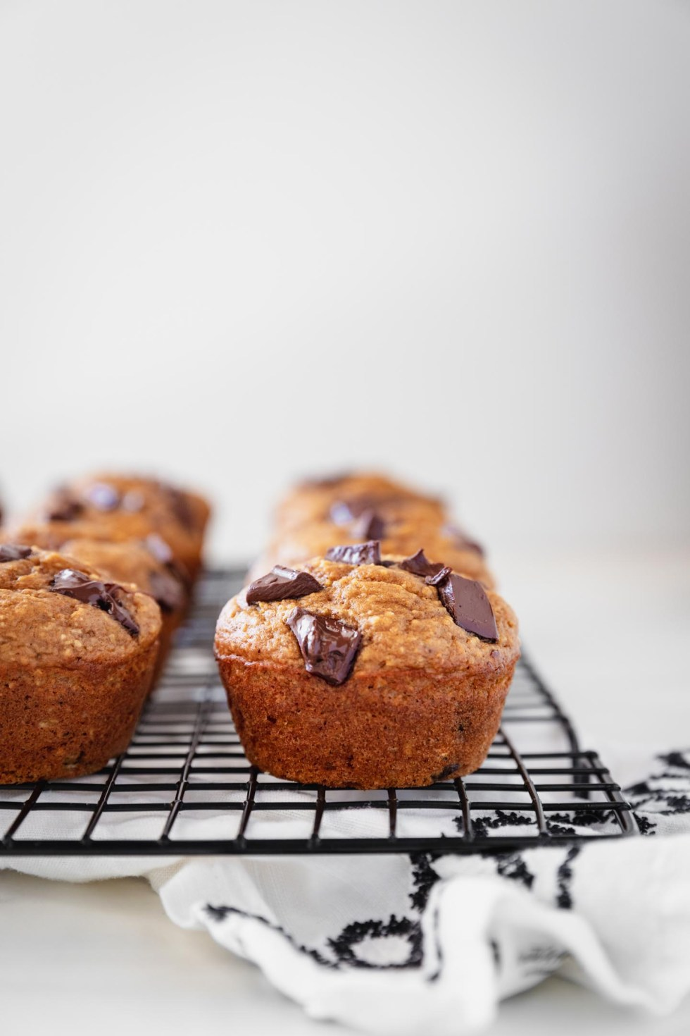 Close-up view of a pumpkin chocolate chip muffin