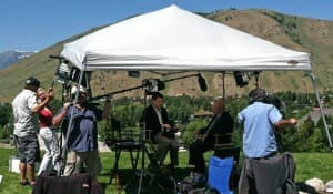 Technicians set up for a cable TV news interview during the Rocky Mountain Economic Summit on Friday in Jackson. (Ruffin Prevost/WyoFile - click to enlarge.)