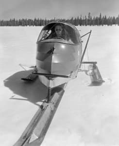 Ranger Bob Richard sits in a snow plane on Yellowstone Lake in the 1950s. The two-person vehicles used a small rear-mounted airplane engine and propeller to glide across ice and snow at high speeds. (Jack Richard photo courtesy of Buffalo Bill Historical Center - click to enlarge)