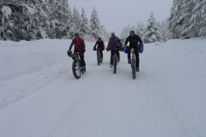 Attendees of last year's Fat Bike Summit ride near West Yellowstone, Mont. The summit brings together bike enthusiasts and land managers to talk about ways fat bikes can share trails and roads. (Photo Courtesy Joe Meiser)