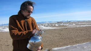 University of Wyoming atmospheric sciences professor Dr. Robert Field uses a canister to collect an air sample as part of a spatial air quality assessment in the Pinedale Anticline.