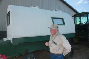 Jay Lillegraven at the restored sheepherder's wagon he conducts work in, which he has named Prairie Argo.