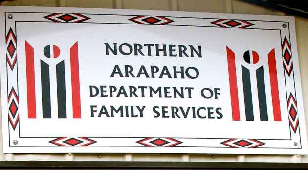 The sign above the entrance of the Northern Arapaho Nation Department of Family Services in Arapahoe, Wyoming