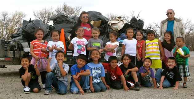 Children from the Arapaho Immersion Preschool with their teachers, Alvena Oldman (left) and Mary Ann Headley. (Ron Feemster/WyoFile — click to view)