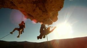 """Kyle Duba, left, films at """"Suicide Point"""" for his film """"Wind and Rattlesnakes; the Birth of a Western Climbing Town,"""" which debuts Thursday during the International Climbers' Festival."""