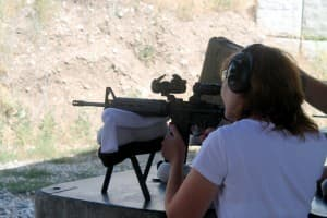 Barbara Andrulonis shoots an LWRC AR-15 with premier telescopic Aimpoint sight and 3x magnifier during a session with the Jackson Hole Shooting Experience. (Wyofile photo by Kelsey Dayton)