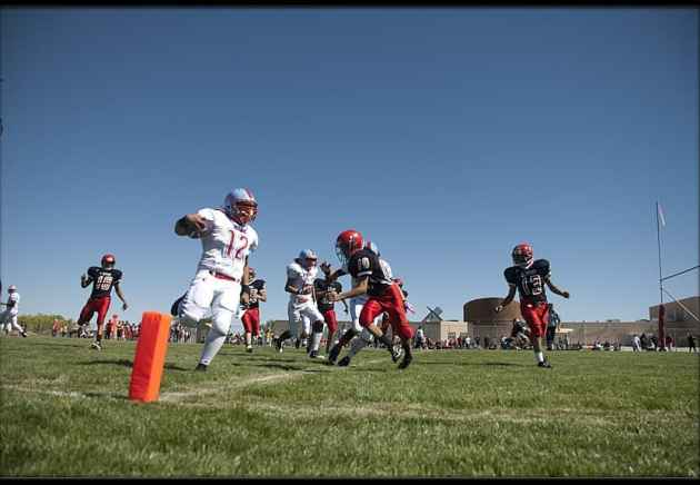 Ramiro Gonzales scores a touchdown for the Wyoming Indian Chiefs on Friday. The six-man football matchup between the Chiefs and the St. Stephens Eagles was the first — and may be the last — six-man game between native schools on the Wind River Indian Reservation. (Morgan Tyree / Six-Eight-Eleven — click to enlarge) (hyperlink to six-eight-eleven.blogspot.com)