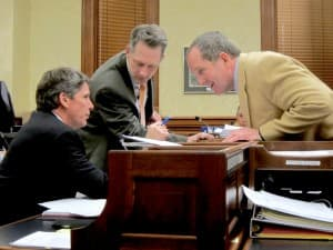 Rep. Steve Harshman (right) confers with Rep. Tim Stubson (R-Casper) and Rep. Bob Nicholas (R-Cheyenne) at right during the conference committee. Shortly after this discussion Rep. Nicholas introduced the amendment on compensation that concluded the night's proceedings. (WyoFile/Gregory Nickerson — click to enlarge)