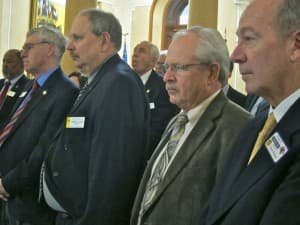 Audience members listen to the announcement of the Halliburton donation to the University of Wyoming. Left to right:  Secretary of State Max Maxfield, Speaker of the House Tom Lubnau (R-Gillette), and lobbyists Bob Tarantola and Bruce Hinchey. (WyoFile/Gregory Nickerson — click to enlarge)