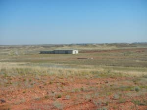 The Two Elk location next to Black Thunder mine features only an empty metal building and a concrete apron. (Rone Tempest/WyoFile — click to enlarge