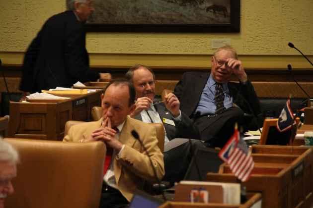 Sen. Bill Landen (R-Casper), Sen. Larry Hicks (R-Baggs), and Sen. Charlie Scott (R-Casper) listen to testimony on Monday. Landen and Scott serve on the Labor Committee, which will hear Medicaid expansion bills on Wednesday. (Gregory Nickerson/WyoFile)
