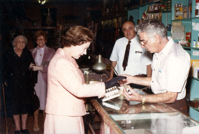 Sam Mavrakis rings up a sale to Queen Elizabeth II at the Ritz Sporting Goods in Sheridan, 1984. Sheridan County Museum.