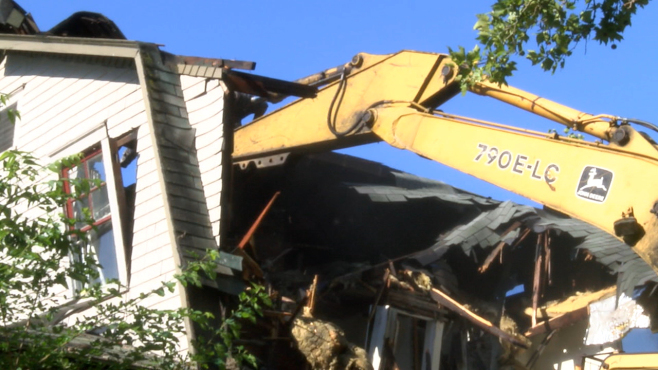 Youngstown Air Reservists tear down blighted homes_47007