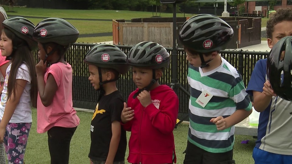 KNR hands out bike helmets in Youngstown