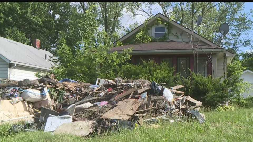 Youngstown vacant house trash pile on East Dewey Avenue
