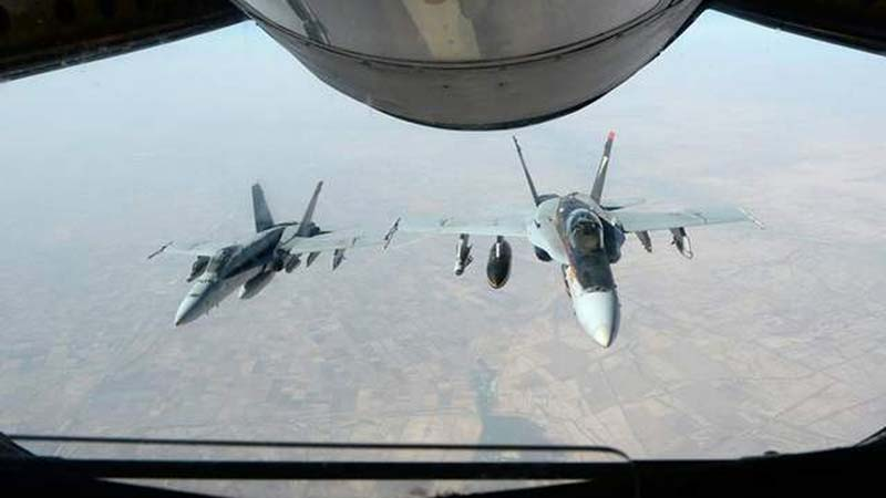 Two US Navy F-18E Super Hornets supporting operations against the Islamic State on Oct. 4. (Photo by AFP)