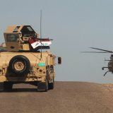 Iraqi army vehicles helicopter in Anbar